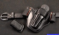 Custom M-11 Gun Holster, belt and matching pouch with black shark trim.
