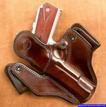 Rear leather guard on the m-11 concealed carry holster for a 1911 pistol